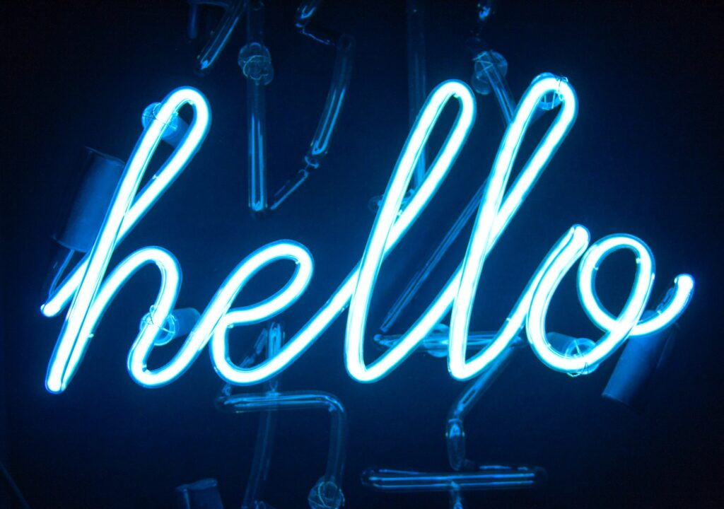 neon sign which reads 'hello'