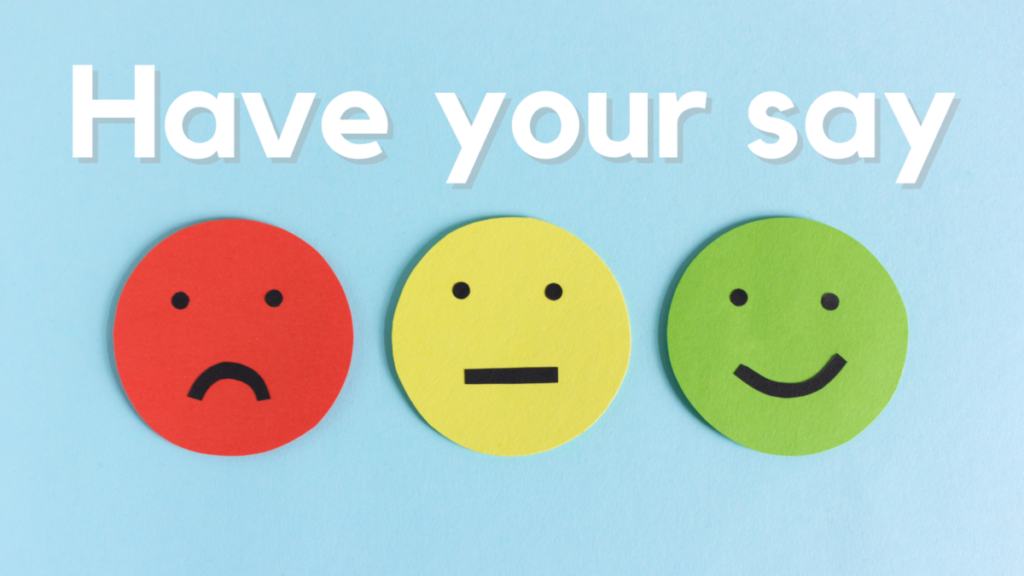 'Have your say' above red, yellow and green paper circles with faces drawn on them. They are frowning, neutral and smiling respectively.